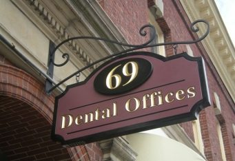 architectursl signage sign design gold dentist signage carved signhanging carved sign newton ma business signage cambridge ma boston burlington