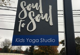 dimensional yoga sign custom retail signage business sign outdoor lexington ma