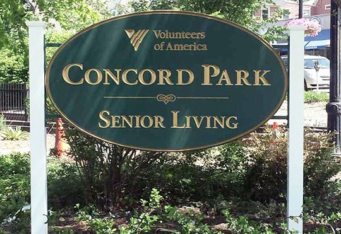 carved HDU senior living sign post sign concord ma carved gold sign