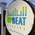 upbeat cycle dinensional carved sign arlington ma exterior store sign