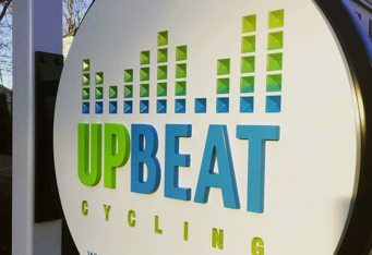 upbeat cycle dinensional carved sign arlington ma
